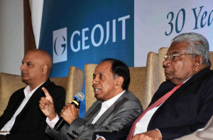 MUMBAI, (GNI): Geojit Financial Services Founder and Managing Director C J George, Chairman, A P Kurian, Managing Director of Geojit Technologies Ltd, A Balakrishnan & Executive Director, Satish Menon,after unveiling the new logo of Geojit, at Hotel Taj Palace, in Mumbai on Wednesday - photo by Sumant Gajinkar