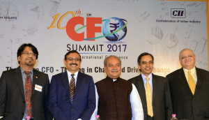 MUMBAI, (GNI): Narendra Singh Tomar, Union Minister of Rural Development, Panchayati Raj & Drinking Water and Sanitation, Govt of India, V S Parthasarathy , Chairman – CII CFO Summit and Group CFO  and Group CIO - Mahindra & Mahindra , Dr Saugat Mukherjee, CII Regional Director, R Shankar Raman, Whole-time Director & CFO Larsen & Toubro Ltd., Porus Doctor, Deloitte India Hon'ble Minister Released CII-Deloitte report Exclusive Report 'The Future CFO – Thriving in Chaos and Driving Change' at CII CFO Summit in Financial Capital of India, Minister addressing at CII CFO Summit in Financial Capital of India, in Mumbai - photo by Sumant Gajinkar