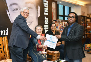 MUMBAI, (GNI): Joseph P Chacko, Publisher of Frontier India presents a Royalty cheque to Cmde Arun Kumar (Retd)  and Ms Deepa Kumar. Arrab Goswami in the background, in Mumbai - photo by GNI