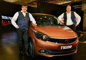 MUMBAI, (GNI): Tata Motors launches India's first Styleback - Tata Tigor. (L to R) Mayank Pareek, President – Passenger Vehicle Business Unit, Tata Motors and Guenter Butschek, CEO & MD, Tata Motors at the launch of the Tata Tigor, their third new generation product, embodying IMPACT Design language.- Photo