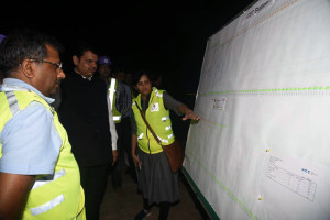 MUMBAI, (GNI): L-R: SK Gupta, Director (Projects), MMRCL, Devendra Fadnavis, Chief Minister of the State of Maharashtra and Ms. Ashwini Bhide, Managing Director, MMRCL reviewing the package for Metro Line III, in Mumbai - Photo by GNI