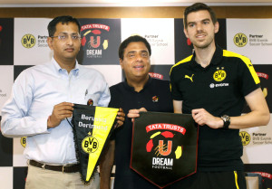 MUMBAI, (GNI): L- R: Mr. R Venkataramanan, Managing Trustee, Tata Trusts;  Ronnie Screwvala, Founder, U Sports; Christian Diercks, Lead-Youth Programmes, BVB Dortmund; exchange pennants at the announcement of the partnership between Tata Trusts - UDream Football and Borussia Dortmund of the Bundesliga. A one of a kind partnership between Tata Trusts U Dream Football and BVB Dortmund that gives an opportunity to the footballers in India to train under BVB Dortmund's Youth Coaches, in Mumbai - photo by GNI