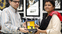 MUMBAI, (GNI): S. Ravi Kant, Chief Executive Officer, Watches & Accessories, Titan Company Limited with Ms. Usha Shetty, a regular and loyal customer of Titan as she buys the first watch from Titan Octane's Squadron collection during its launch event at the inauguration of Titan's revamped World of Titan store in Holland House, Colaba, in Mumbai  - Photo by GNI