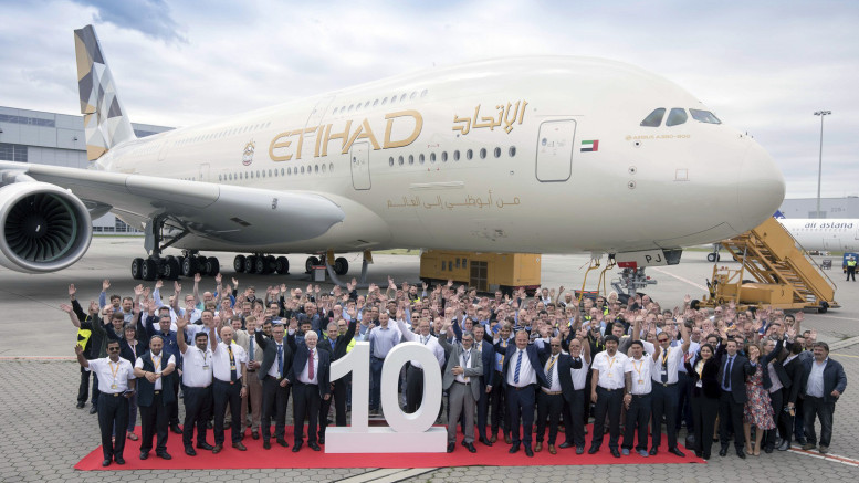 GERMANY, (GNI): Etihad Airways and Airbus employees celebrate the handover of the airline's 10th and final Airbus A380 at Hamburg Finkenwerder - photo by GNI