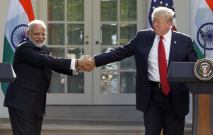 U.S. President Donald Trump (R) greets Indian Prime Minister Narendra Modi during their joint news conference in the Rose Garden of the White House in Washington, U.S.,