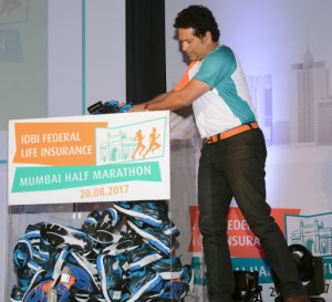 MUMBAI, (GNI): Sachin Tendulkar donates 100 pairs of shoes to IDBI Federal Life Insurance Mumbai Half Marathon initiative to support Green Soles at the IDBI Federal Life Insurance Mumbai Half Marathon press conference in Mumbai - Photo by GNI