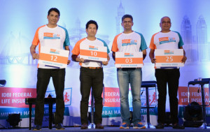 MUMBAI, (GNI): From L-R: Vighnesh Shahane, CEO, IDBI Federal Life Insurance, Face of the event, Sachin Tendulkar, Karthik Raman, CMO, IDBI Federal Life Insurance and Race Director, Nagaraj Adiga with their bib numbers for the IDBI Federal Life Insurance Mumbai Half Marathon ,in Mumbai - photo by GNI