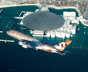 An Etihad Airways Airbus A380 conducts a low-level fly-by of the new Louvre Abu Dhabi