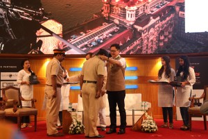 Kiren Rijiju facilitating Arun Jadhav, Head Constable - Crime Branch at the 26-11 Memorial Day Event at BSE