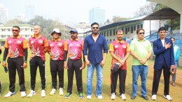 Suniel Shetty with Mehul Shah, Director, Anchor Group and Great White Tusker Team during National Anthem at Anchor Premier League