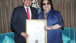 Santosh Shukla and Bappi Lahiri at the felicitation of Bappi Lahiri by The World Book Of Records at Lahiri House, Juhu 2