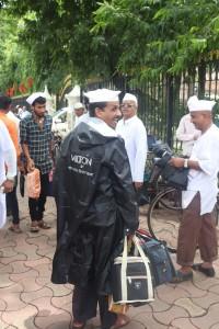 Happy Dabbawalas after recieving raincoats from Milton