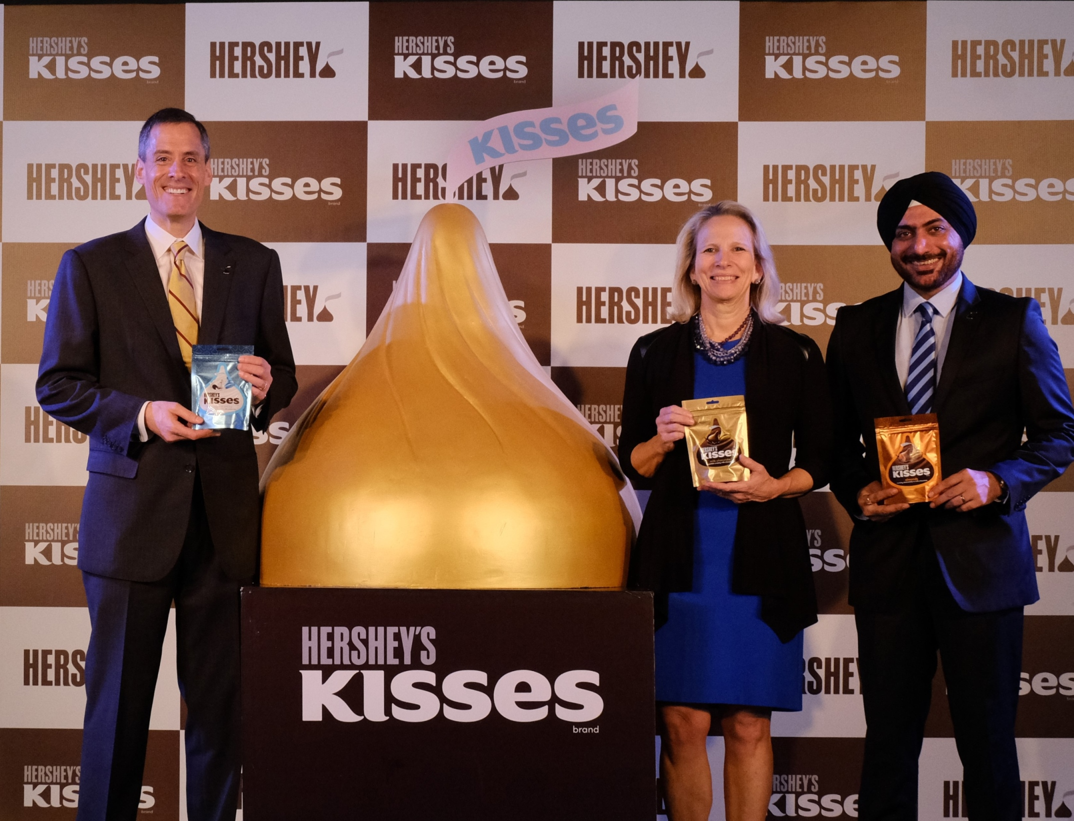 L-R-Steven-Schiller-President-International-The-Hershey-Company-Michele-Buck-President-and-CEO-The-Hershey-Company-and-Herjit-Bhalla-MD-Hershey-India-at-the-launch-of-Hersheys-Kisses.jpg October 17, 2018