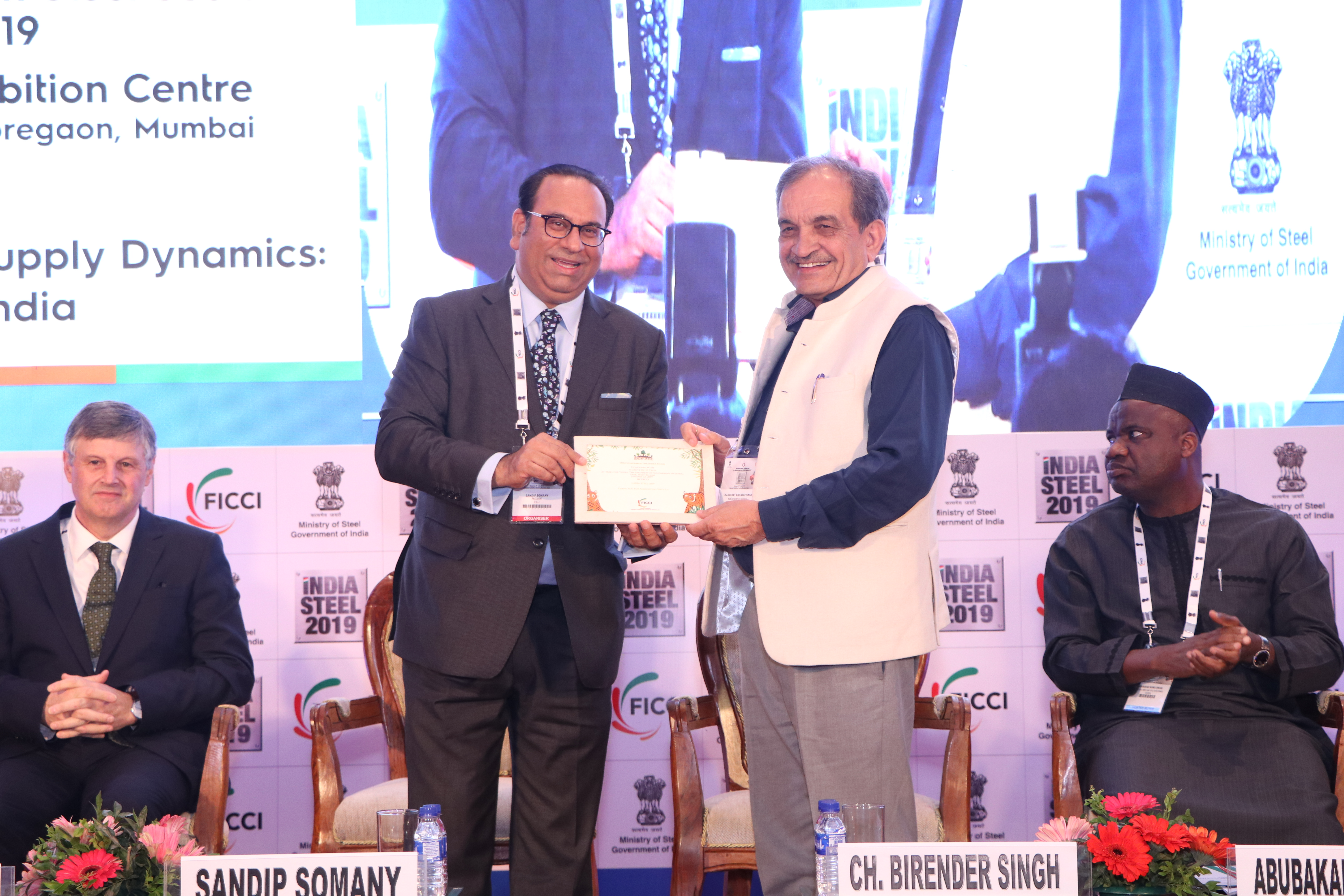Mr.Sandip Somany, President, FICCI honors the Hon'ble Minister of Steel, Mr. Chaudhary Birender Singh at FICCI's India Steel 2019
