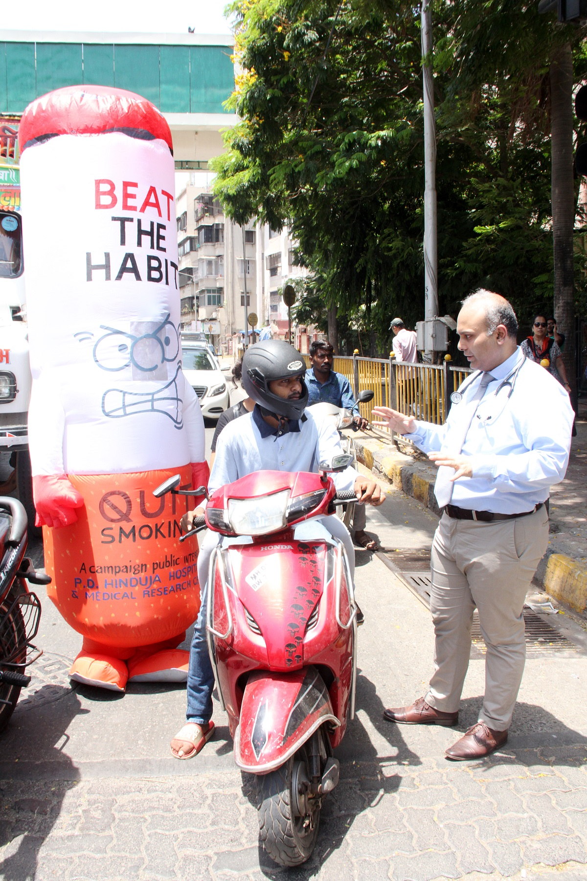 On Occasion of World No Tobacco Day - Cigarette Mascotts and Dr Lancelot Pinto encouraging people to quit smoking